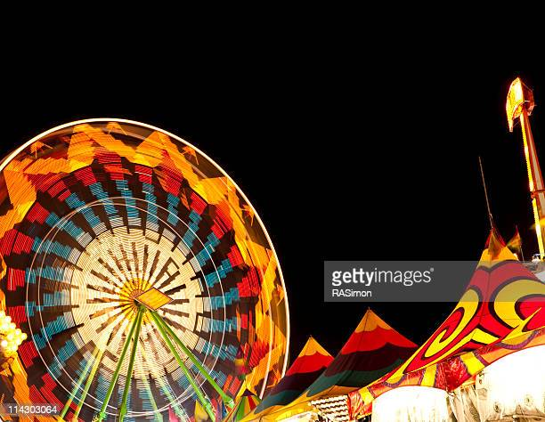 ferris wheel and carnival tents - midway stock photos and pictures