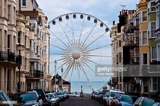 CONTENT] Ferris wheel and sea at the end of a street in Brighton