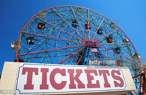 Ferris wheel and tickets sign at fairgrounds