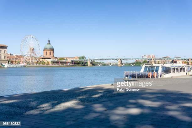 Ferris Wheel and view of Saint-Pierre Bridge over Garonne river and Dome de la Grave in Toulouse