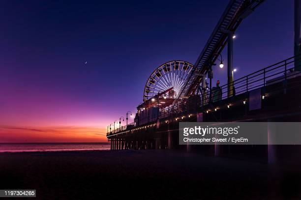 ferris wheel at beach during night - santa monica stock pictures, royalty-free photos & images