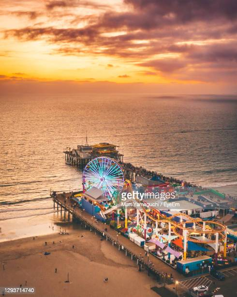ferris wheel at beach during sunset - santa ana california stock pictures, royalty-free photos & images