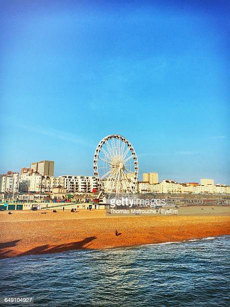 Ferris Wheel At Brighton Beach Against Blue Sky On Sunny Day In City