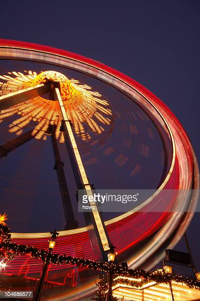 ferris wheel by night with long exposure - east berlin stock photos and pictures