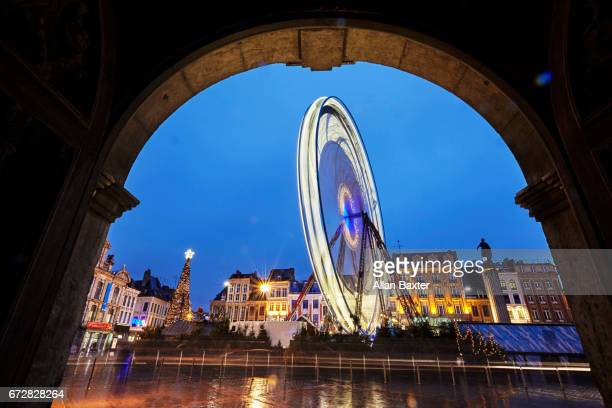 Ferris wheel illuminated at night at Christmas market in Central Lille