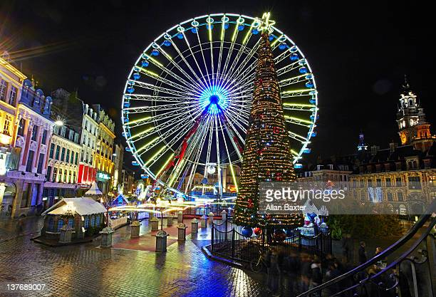 ferris wheel in central lille - france lille stock pictures, royalty-free photos & images