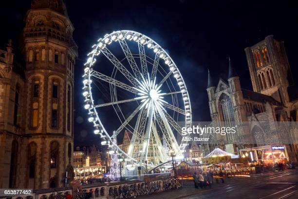 ferris wheel in ghent christmas market at night - ベルギー ゲント ストックフォトと画像