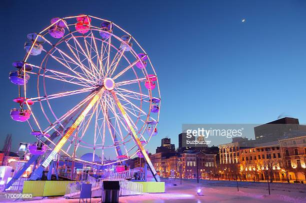 ferris wheel in old montreal during winter - buzbuzzer stock pictures, royalty-free photos & images