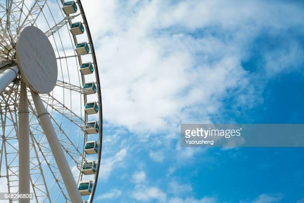 Ferris wheel on blue sky,Hong Kong