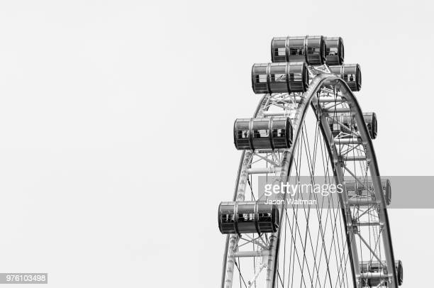 ferris wheel on white background, singapore - singapore flyer stock photos and pictures