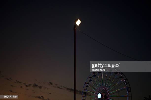 A ferris wheel stands at night during the Iowa State Fair in Des Moines Iowa US on Thursday Aug 8 2019 The 2020 Democratic field is gathering in Iowa...