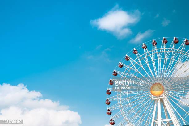 ferris wheel with blue sky in okinawa japan. - carnival stock pictures, royalty-free photos & images
