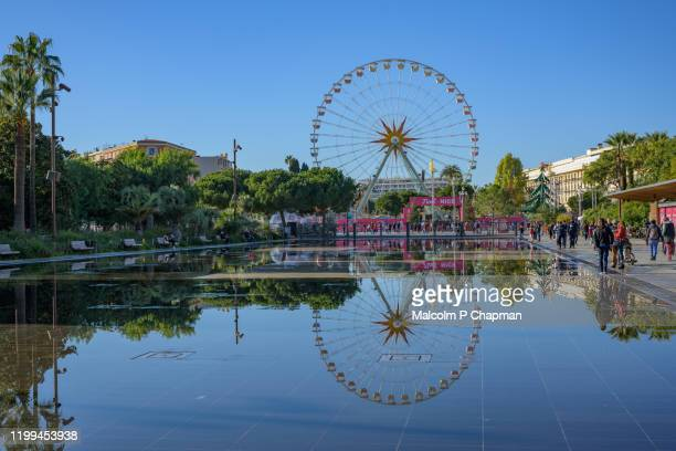 ferris wheel with reflection in pool, nice, cote d'azur, provence, france - nice france stock pictures, royalty-free photos & images