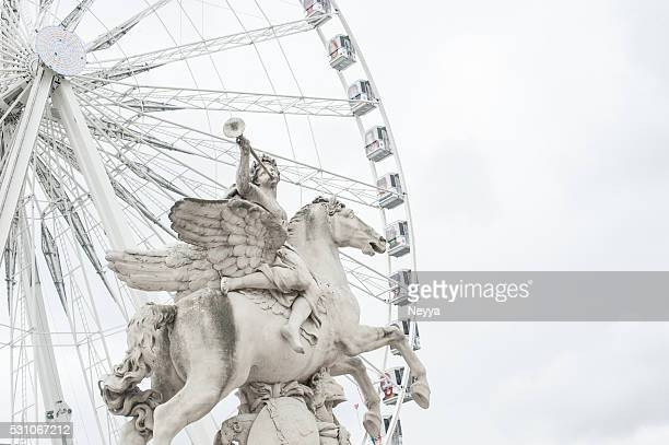 Ferris Wheel With Statue