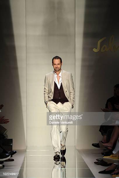Ferrogamo Men's Creative Director Massimiliano Giornetti acknowledges the applause of the public after the Salvatore Ferragamo Milan Menswear...