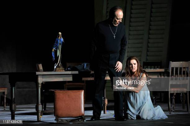 Ferruccio Furlanetto as Padre Guardiano and Anna Netrebko as Donna Leonora in The Royal Opera's production of Giuseppe Verdi's La forza del destino...