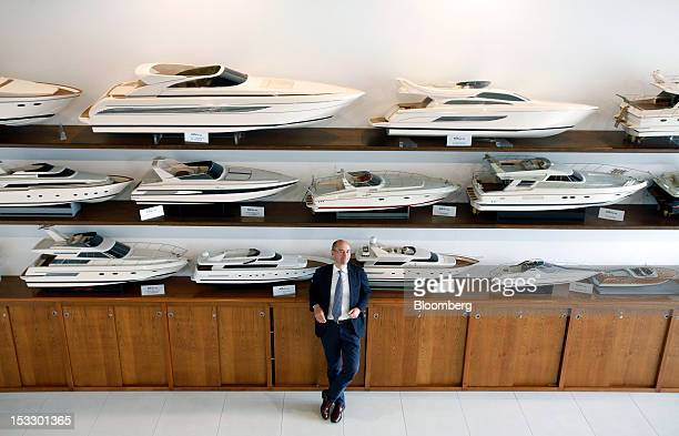 Ferruccio Rossi chief executive officer of Ferretti Group's Riva boat unit poses for a photograph in the company's offices in Sarnico Italy on...