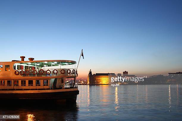 ferry and haydarpasa port at dusk - kadikoy stock photos and pictures
