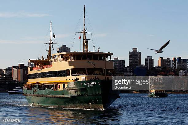 A ferry approaches Circular Quay Wharf in Sydney Australia on Tuesday June 9 2015 Australian wages fell in the first quarter for the first time on...
