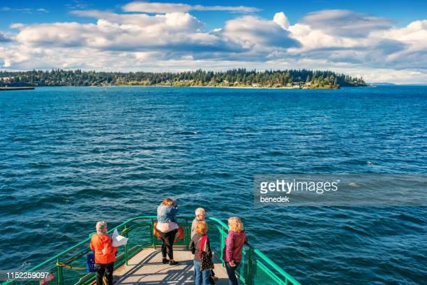 ferry approaching bainbridge island puget sound washington usa - bainbridge island stock pictures, royalty-free photos & images