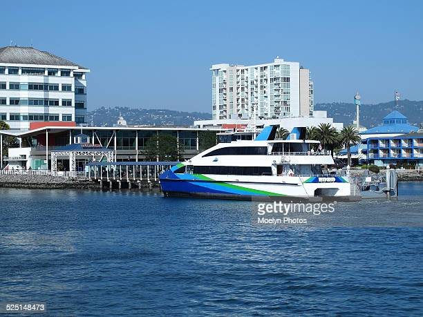 ferry arrives at jack london square-oakland - jack london stock pictures, royalty-free photos & images