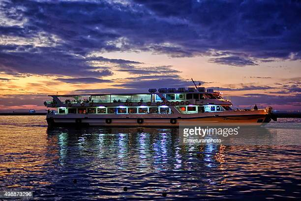 ferry arriving at terminal at sunset - emreturanphoto stock pictures, royalty-free photos & images