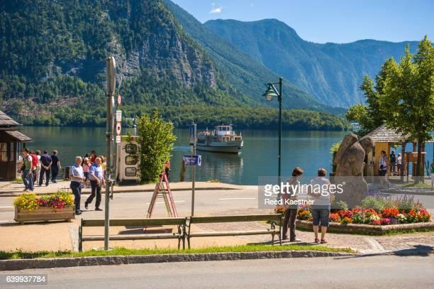 A ferry boat arrives at the dock in Hallstatt, Austria
