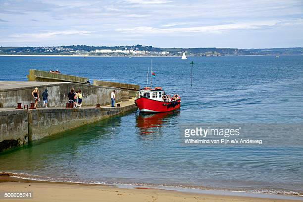 Ferry boat arriving at Caldey Island, Wales, UK. Caldey is a small island off the SW coast of mainland Wales, near Tenby in Pembrokeshire. With a...