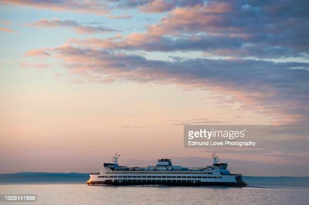 ferry boat crossing elliott bay from seattle to bainbridge island. - ferry stock photos and pictures