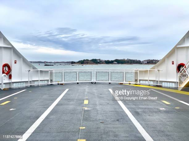 ferry boat deck looking over the empty harbor - 船のデッキ ストックフォトと画像