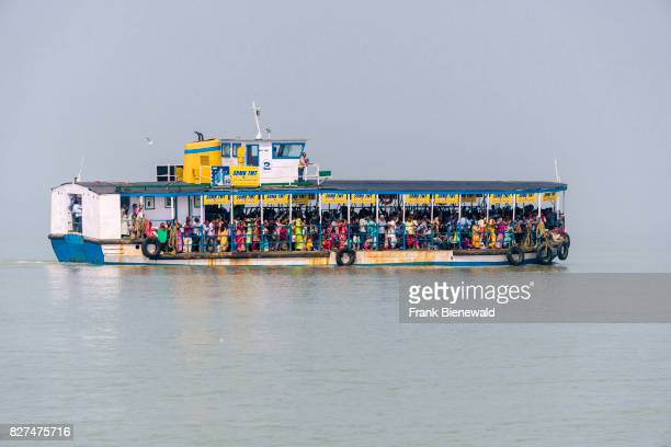 A ferry boat full with pilgrims at the jetty in Kakdwip is leaving for Ganga Sagar Island in the Gulf of Bengal