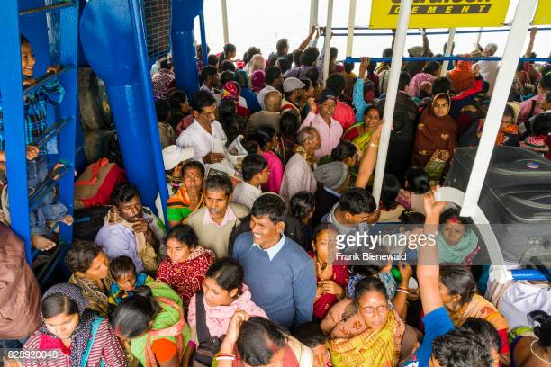 A ferry boat full with pilgrims at the jetty in Kakdwip is ready to leave for Ganga Sagar Island in the Gulf of Bengal
