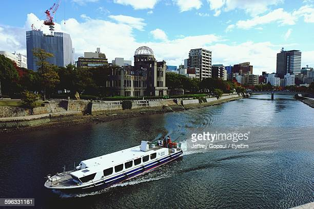 Ferry Boat In Ota River With Hiroshima Peace Memorial In City