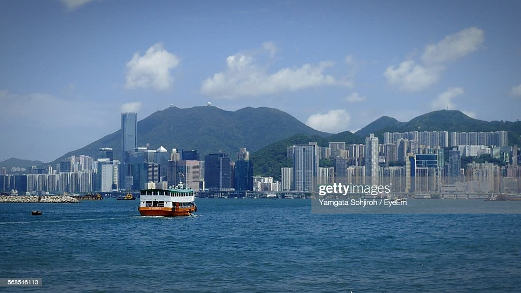 Ferry Boat In Victoria Harbour Against Sky : Stock Photo