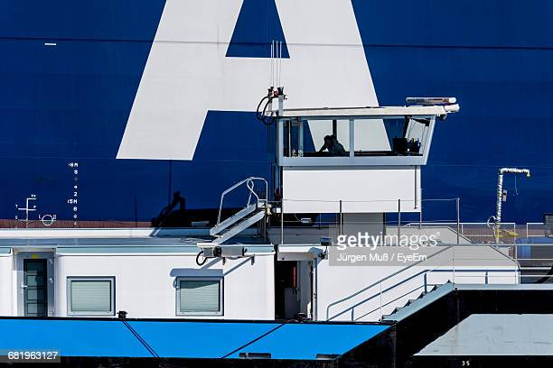 Ferry Boat Moored Against Blue Ship