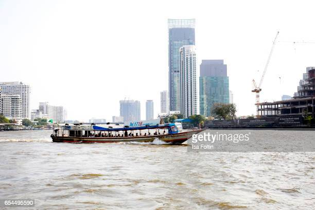 A ferry boat on the Chao Phraya River on March 16 2017 in Bangkok Thailand