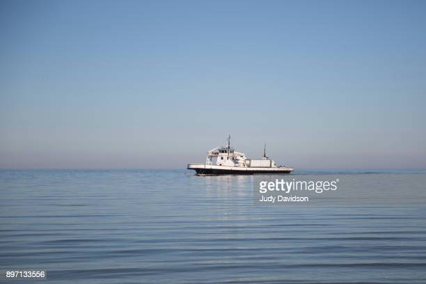 Ferry boat on the water with blue sky