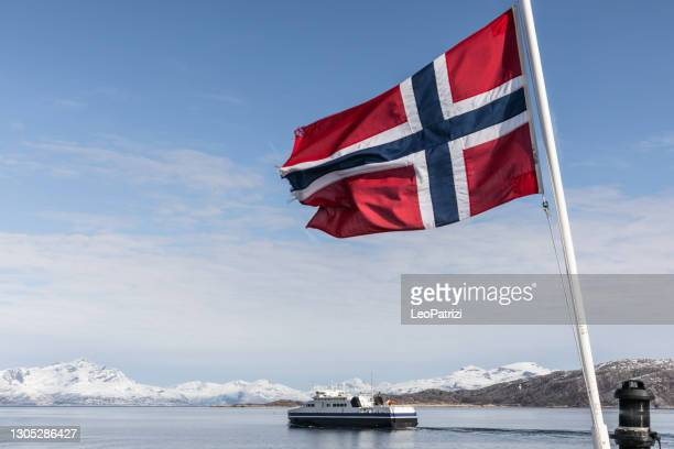 ferry boat sailing in norwegian fjords - norwegian flag stock pictures, royalty-free photos & images