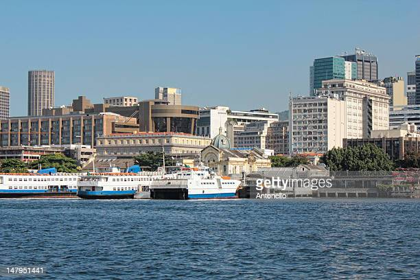 ferry boat station with downtown - 旅客船 ストックフォトと画像