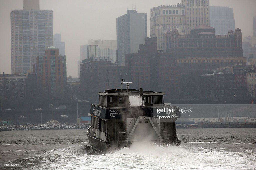 A ferry boat traverses the East River as it snows during the morning commute on January 28, 2013 in New York City. Following some of the coldest weather this winter, temperatures are expected to gradually warm during the week in New York.