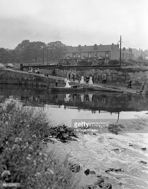 Ferry boat wedding party Mexborough South Yorkshire 1960 A wedding party crosses the River Don on a trditional rope pulled barge