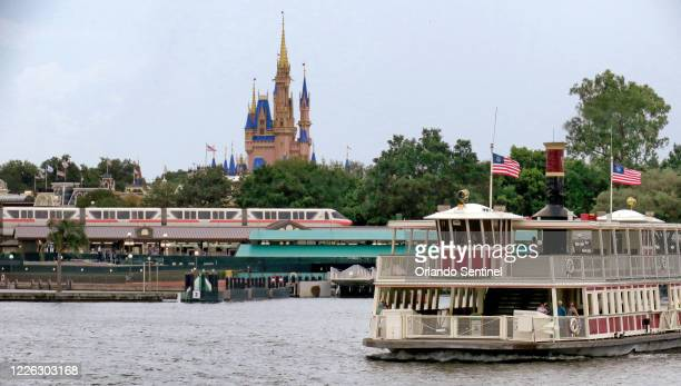 Ferry boats and monorails operate during the official re-opening day of the Magic Kingdom at Walt Disney World in Lake Buena Vista, Florida, on...