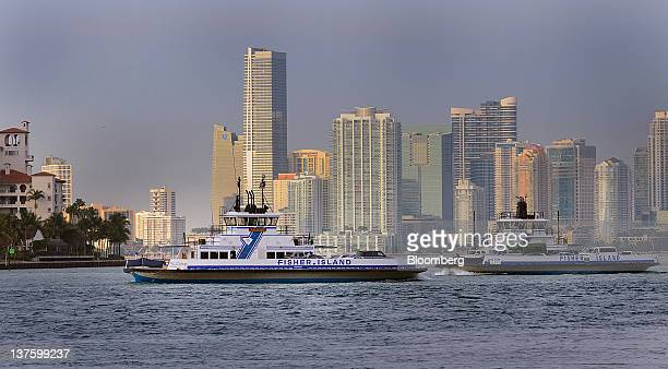 Ferry boats sail to and from Fisher Island in Miami Florida US on Friday Jan 13 2012 Florida will hold its Republican presidential primary on Jan 31...