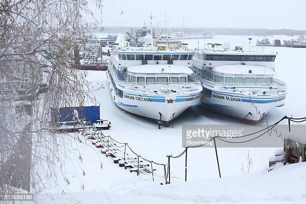 Ferry boats sit in ice at the frozen Yakut river port on the Lena River in Yakutsk Sakha Republic Russia on Sunday Feb 14 2016 Yakutsk the capital of...