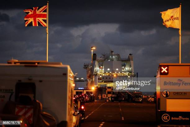 A ferry bound for the English port of Portsmouth prepares to depart from the port of Ouistreham near Caen northwestern France on October 30 2017...