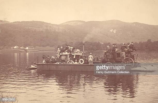 Ferry carries passengers and their transport across Lake Windermere, between Bowness Royal Hotel and Furness Abbey, circa 1880.