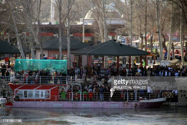 A ferry carrying families docks on March 21 at the site of a popular picnic area in the northern Iraqi city of Mosul on the shores of the Tigris...