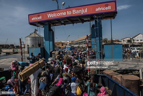 Ferry carrying people who fled Gambia arrives in Banjul a day after authoritarian ex-president Yahya Jemmeh left the country, on January 22, 2017 in...