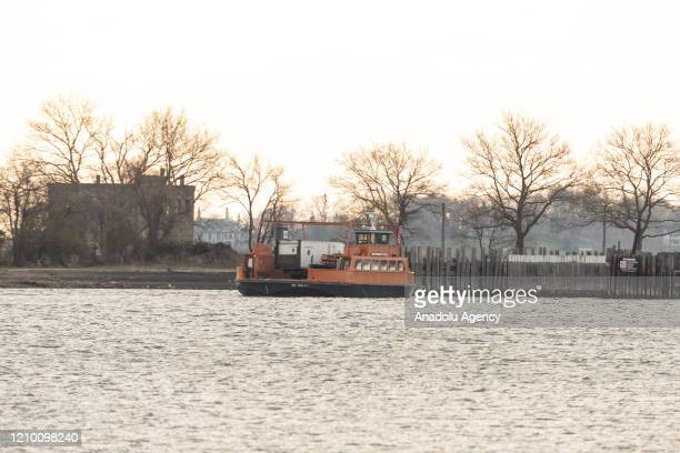 Ferry carrying Special Operation Medical Examiner refrigerated truck move to Hart Island, where unclaimed bodies of COVID-19 victims were buried, in...