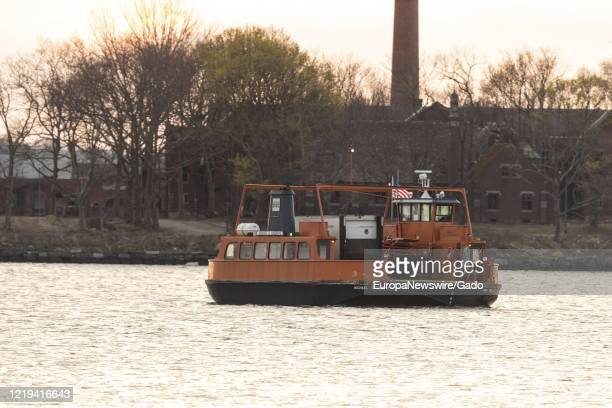 Ferry carrying Special Operation Medical Examiner refrigerated truck with bodies of COVID-19 coronavirus dead, known colloquially as Barge of the...